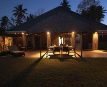 The Villa patio by night with undercover table and chairs for 6 - Ifiele'ele Plantation luxury self-contained holiday home in Samoa
