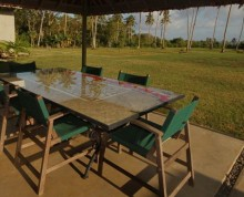 The Villa patio with coconut palms and Pacific Ocean beyond - Ifiele'ele Plantation boutique self-contained holiday rental in Samoa