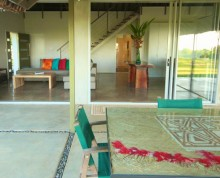 The Villa patio with lounge and dining beyond - Ifiele'ele Plantation boutique self-contained holiday rental in Samoa