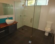 The Studio bathroom at Ifiele'ele Plantation luxury self-catering holiday rental in Samoa